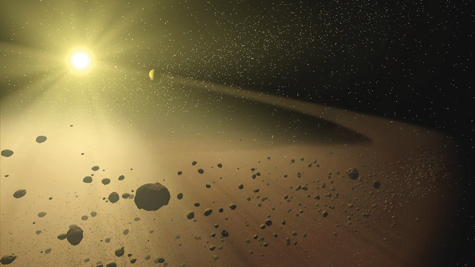 An artist's concept of the asteroid belt. These orbiting rocks may harbor water in unexpected quantities. Photo: NASA
