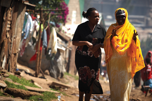 "Jane Otai (left) runs a program that works to improve health care in the slums of Nairobi. ""In the slums,"" she says, ""it's no different from anywhere else—people want to live a good life."" Photo Courtesy of Jhpiego"